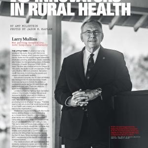 Larry Mullins standing outside smiling.