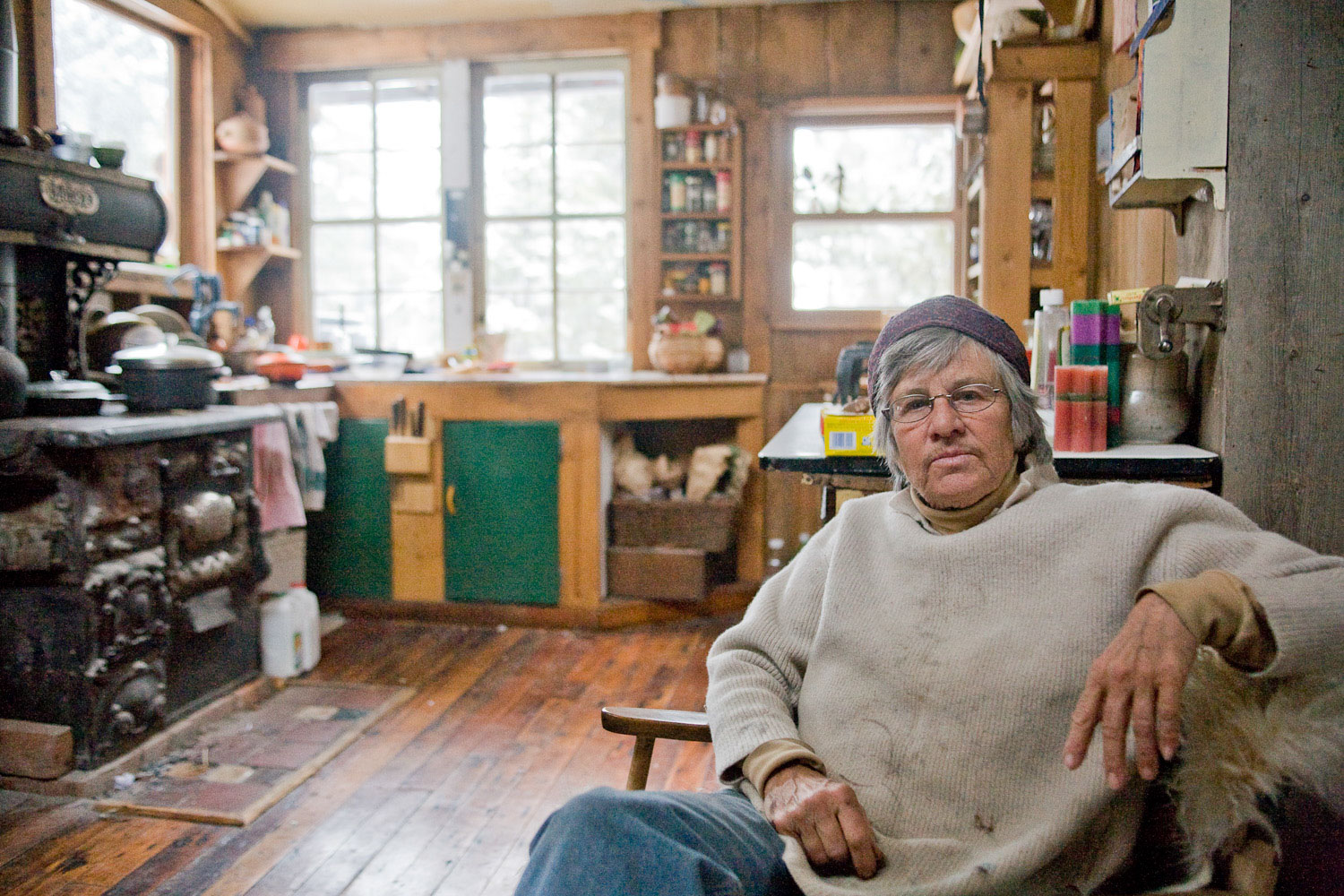 Montana Artist Nan Parsons sits in the rustic house she built herself outside of the small town of Basin