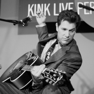 Chris Isaak plays guitar at the KINK Live Performance Lounge