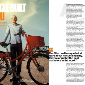 Bike Share Oregon businessman stands with bike