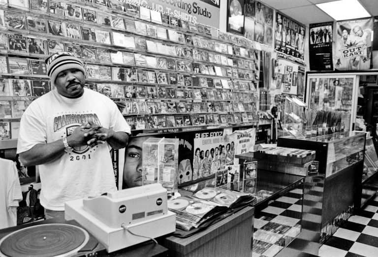 One Love Record owner Octavious behind the counter in portland oregon