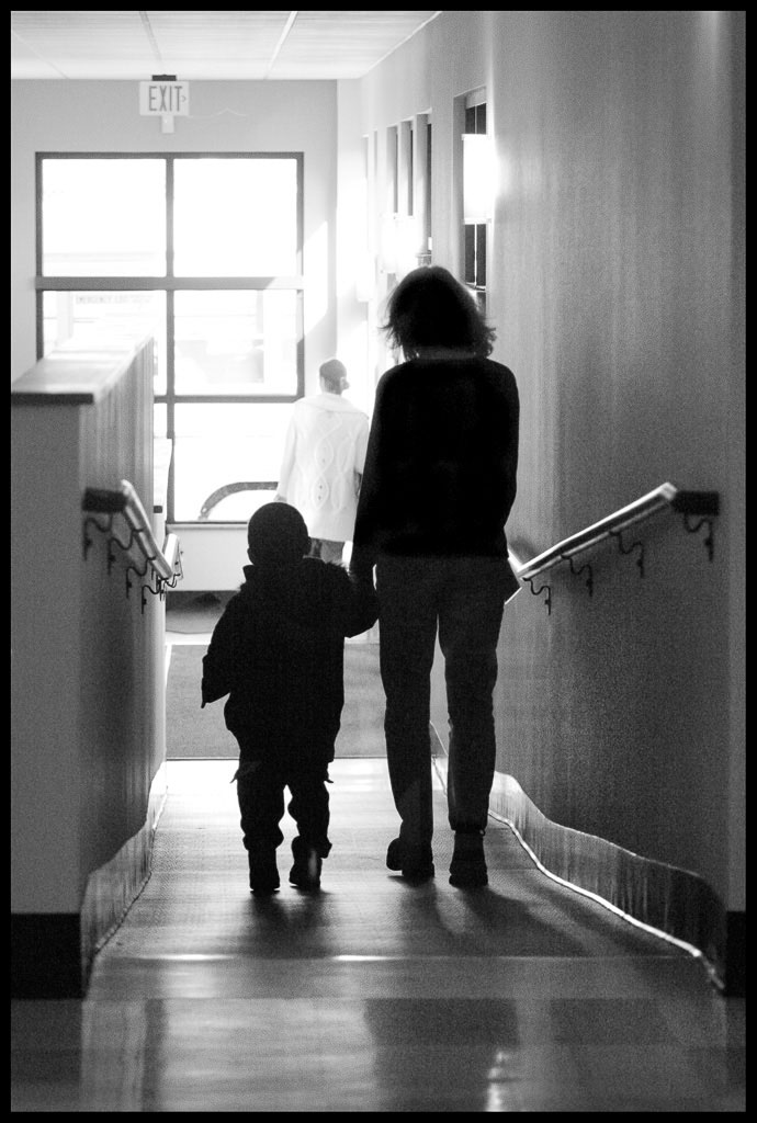Portland Relief Nursery child and adult walk down hall in oregon