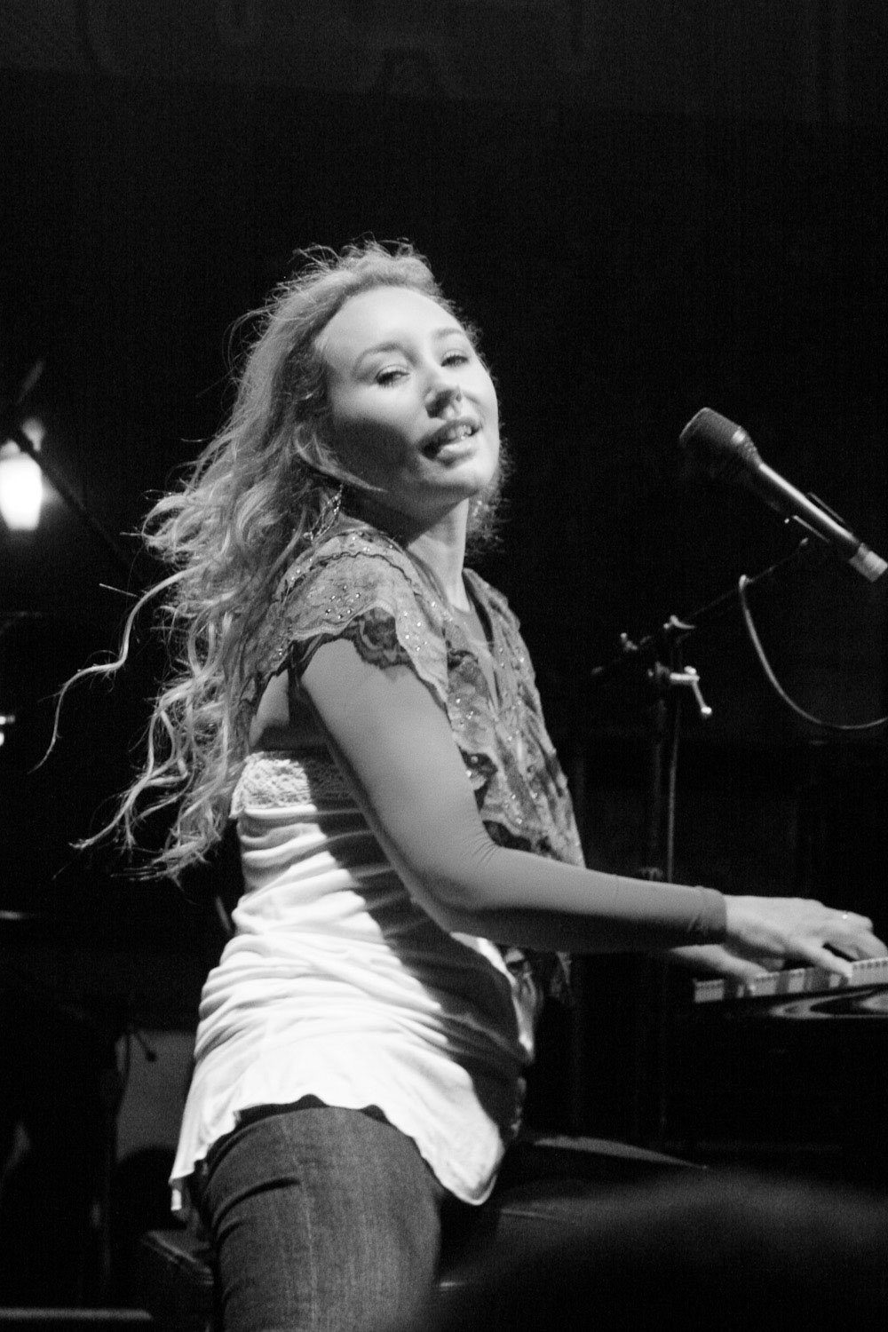 Tori Amos sings and plays piano at a concert in Portland Oregon.