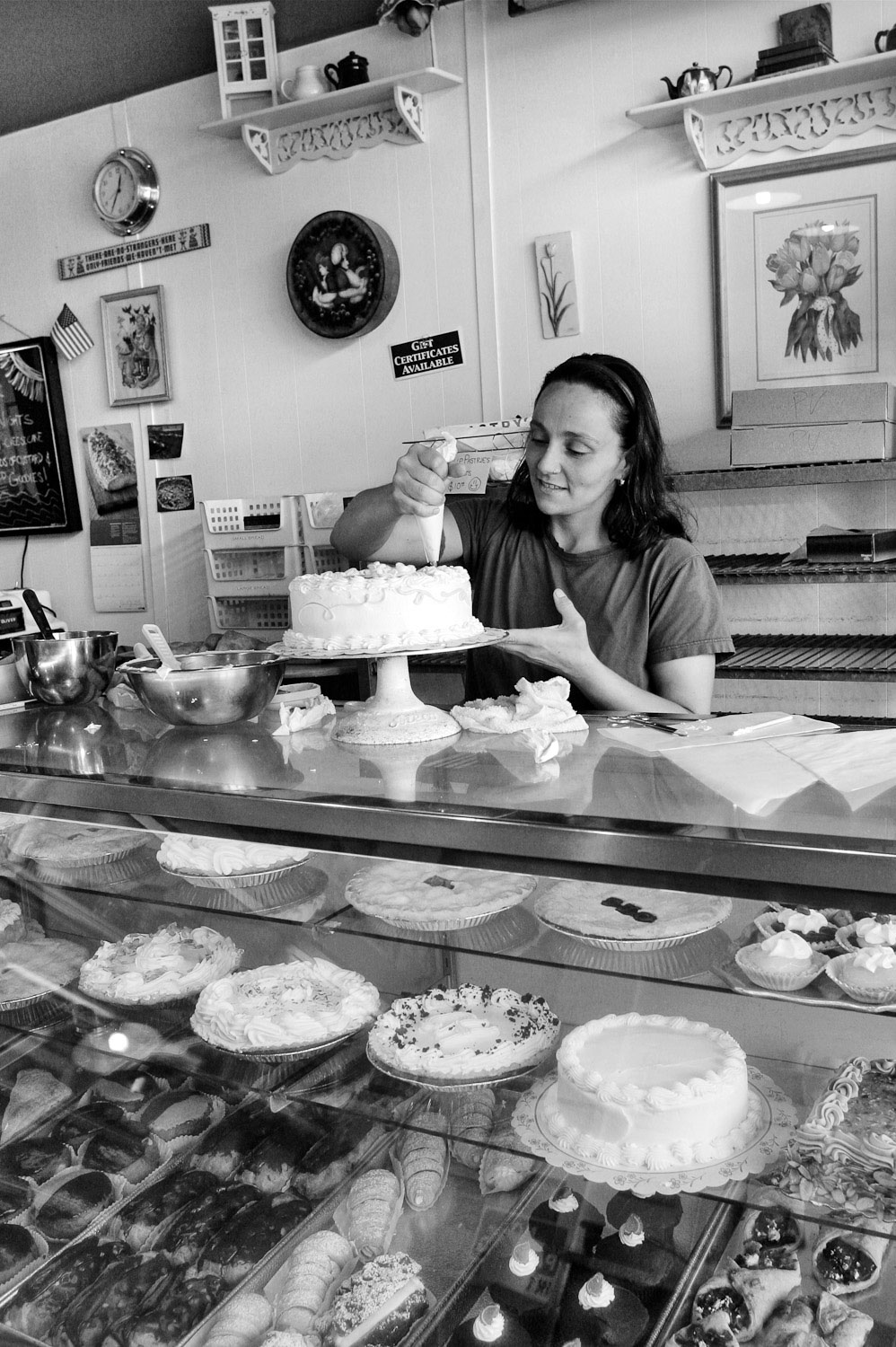 Tulip Pastry Shop employee decorates a cake in St. Johns