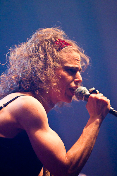 singer holding mike in concert