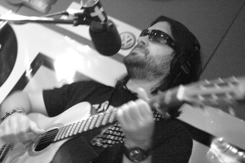 Bob Schneider plays in the studio